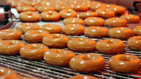 KRISPY KREME DOUGHNUTS GO INTO PRODUCTION AT NEW STORE AT HARRODS IN LONDON.